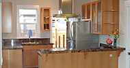Custom Fir cabinets with marble counter tops, island vent hood and breakfast bar